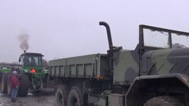 Photo of Video: Tug of War Between a John Deere Tractor and a Military 6X6