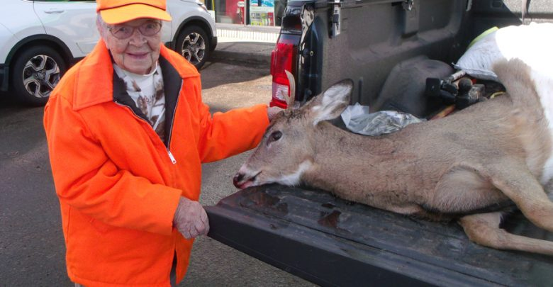 Florence Teeters stands with her first buck on her first hunt at age 104.